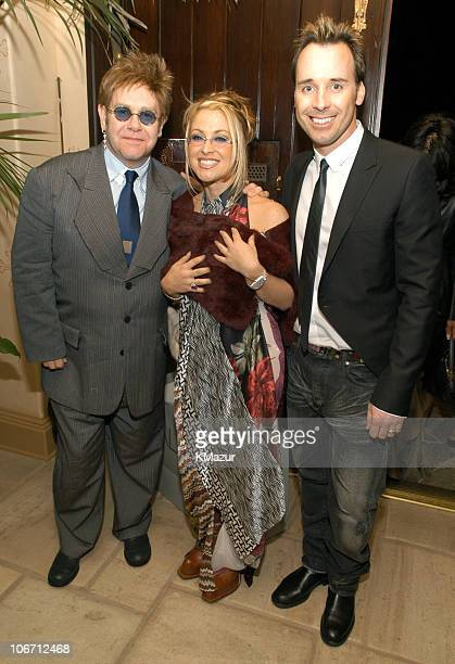 Sir Elton John Anastacia wearing Cantu Castillo Couture and David Furnish