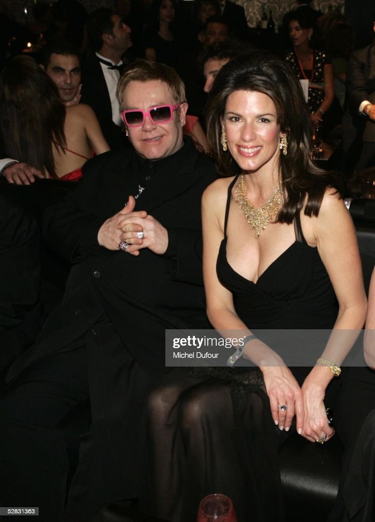 Sir Elton John and a guest attend the Ceremony of the Chopard Trophy Awards at the Carlton Hotel on May 11, 2005 in Cannes, France. The Chopard Trophy is a promotional award that is given to young actors.