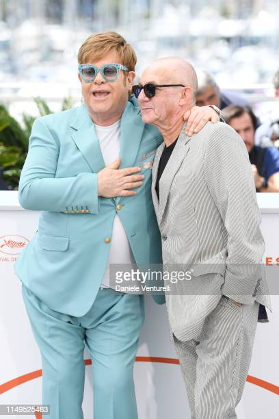 Sir Elton John and Bernie Taupin attend the photocall for Rocketman during the 72nd annual Cannes Film Festival on May 16 2019 in Cannes France