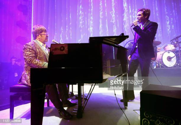 Sir Elton John and Brandon Flowers of The Killers perform onstage during the 27th annual Elton John AIDS Foundation Academy Awards Viewing Party...