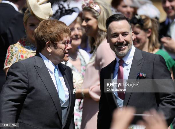 Sir Elton John and David Furnish arrive at the wedding of Prince Harry to Ms Meghan Markle at St George's Chapel Windsor Castle on May 19 2018 in...