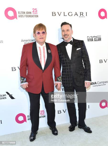 Sir Elton John and David Furnish attend the 26th annual Elton John AIDS Foundation's Academy Awards Viewing Party at The City of West Hollywood Park...