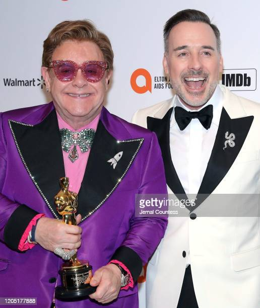 Sir Elton John and David Furnish attend the 28th Annual Elton John AIDS Foundation Academy Awards Viewing Party sponsored by IMDb Neuro Drinks and...