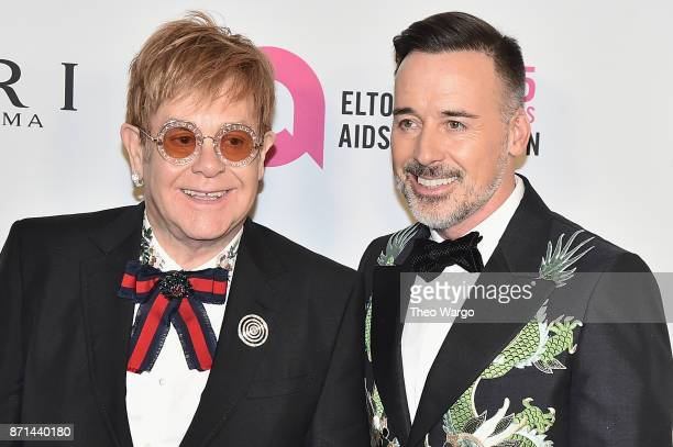 Sir Elton John and David Furnish attend the Elton John AIDS Foundation Commemorates Its 25th Year And Honors Founder Sir Elton John During New York...
