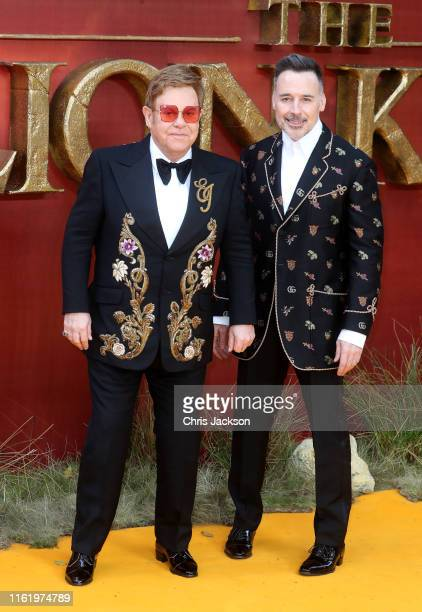 """Sir Elton John and David Furnish attend """"The Lion King"""" European Premiere at Leicester Square on July 14, 2019 in London, England."""