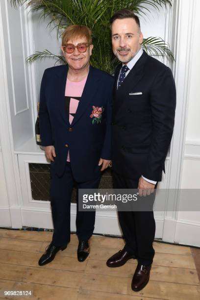 Sir Elton John and David Furnish attend the opening dinner for LFWM June 2018 at the Moët Summer House on June 8 2018 in London England