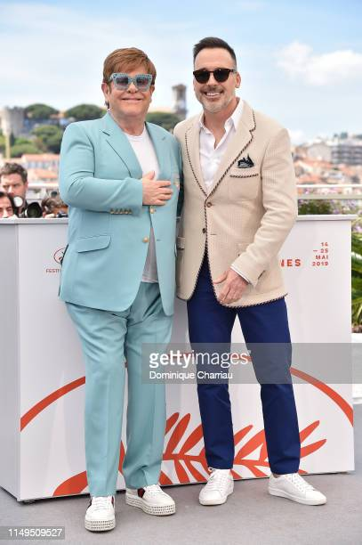 Sir Elton John and David Furnish attend the photocall for Rocketman during the 72nd annual Cannes Film Festival on May 16 2019 in Cannes France