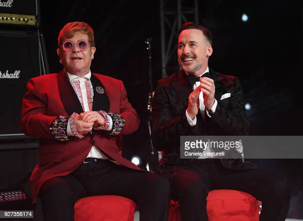 Sir Elton John and David Furnish attends Elton John AIDS Foundation 26th Annual Academy Awards Viewing Party at The City of West Hollywood Park on...