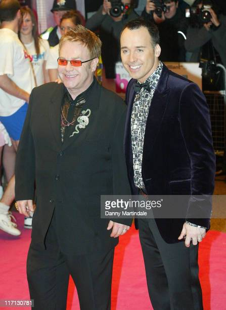 Sir Elton John and David Furnish during It's A Boy Girl Thing - London Premiere in London, Great Britain.