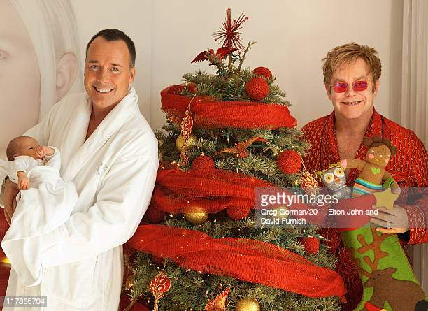 Sir Elton John and David Furnish pose with their son Zachary Jackson Levon Furnish-John on January 11, 2011 at home in Los Angeles, California.
