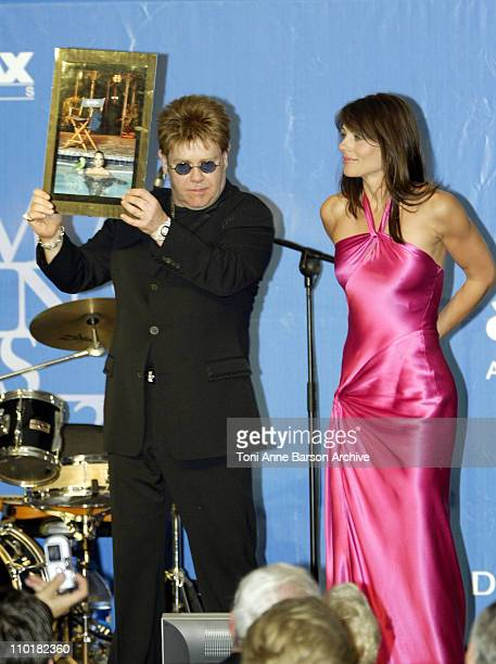 Sir Elton John and Elizabeth Hurley during 2003 Cannes Film Festival Cinema Against Aids 2003 to benefit amfAR sponsored by Miramax Auction at Moulin...