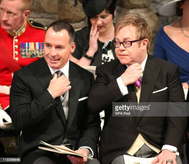 Sir Elton John and his partner David Furnish attend the service inside Westminster Abbey on April 29 2011 in London England The marriage of Prince...
