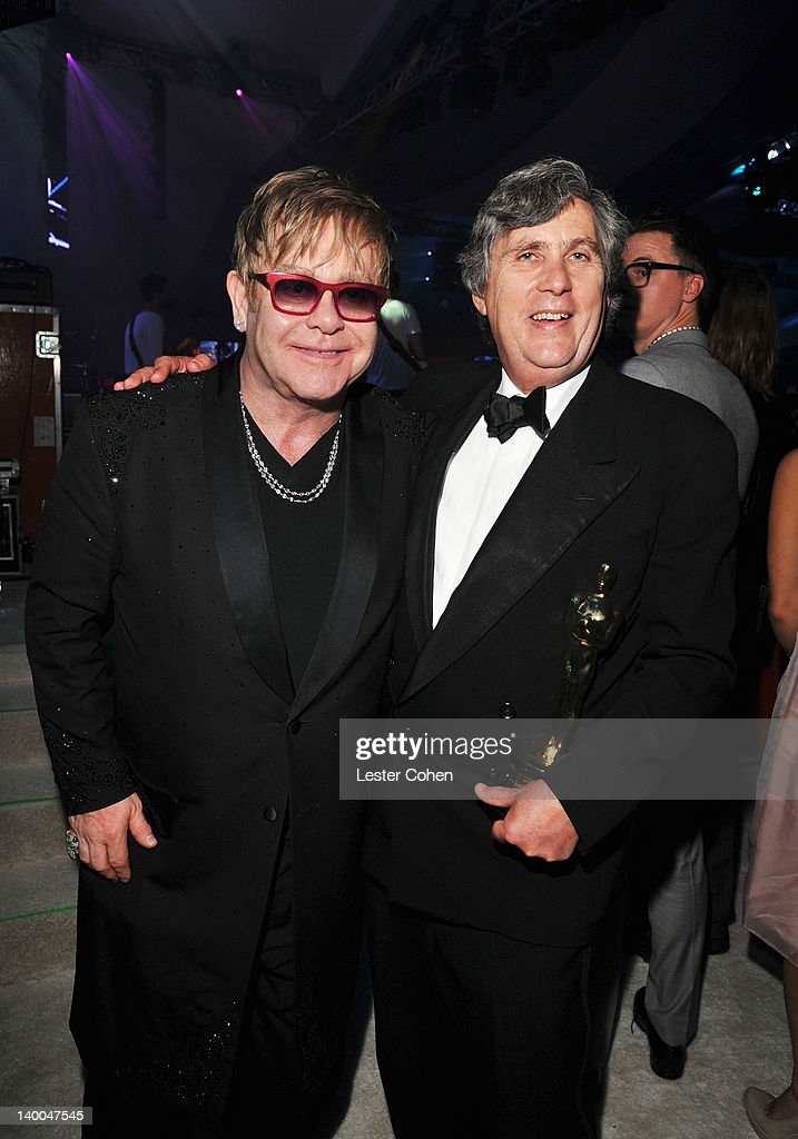 Sir Elton John (L) and John Midgley attend the 20th Annual Elton John AIDS Foundation Academy Awards Viewing Party at The City of West Hollywood Park on February 26, 2012 in Beverly Hills, California.