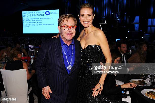 Sir Elton John and model/TV personality Heidi Klum attend the 22nd Annual Elton John AIDS Foundation Academy Awards Viewing Party at The City of West...
