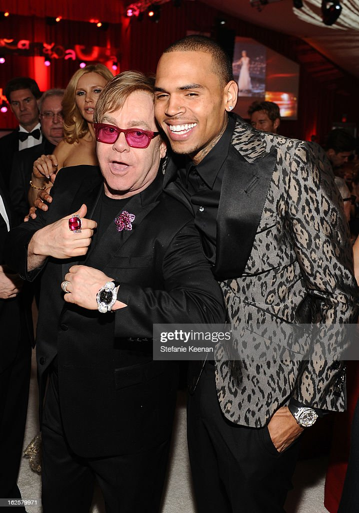 Sir Elton John and singer Chris Brown attend Chopard at 21st Annual Elton John AIDS Foundation Academy Awards Viewing Party at West Hollywood Park on February 24, 2013 in West Hollywood, California.