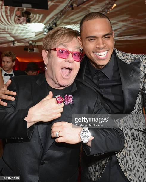 Sir Elton John and singer Chris Brown attend the 21st Annual Elton John AIDS Foundation Academy Awards Viewing Party at West Hollywood Park on...