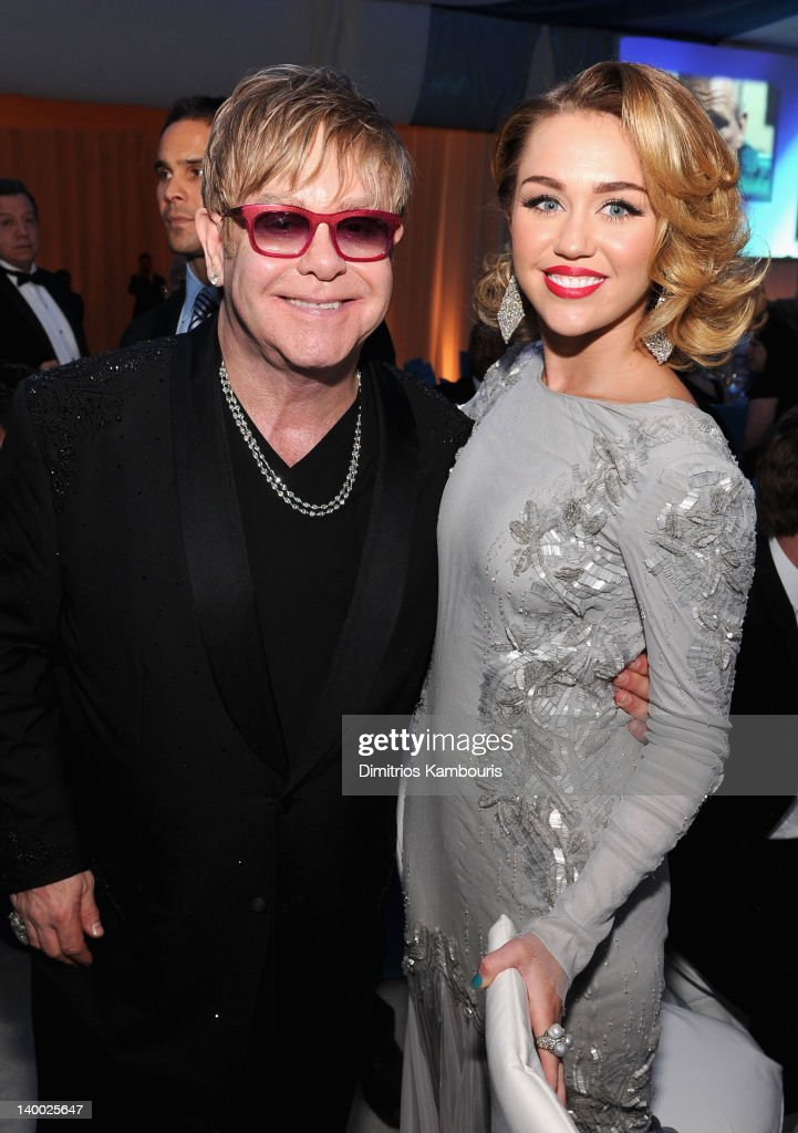 Sir Elton John and Singer Miley Cyrus attends the 20th Annual Elton John AIDS Foundation Academy Awards Viewing Party at The City of West Hollywood Park on February 26, 2012 in Beverly Hills, California.