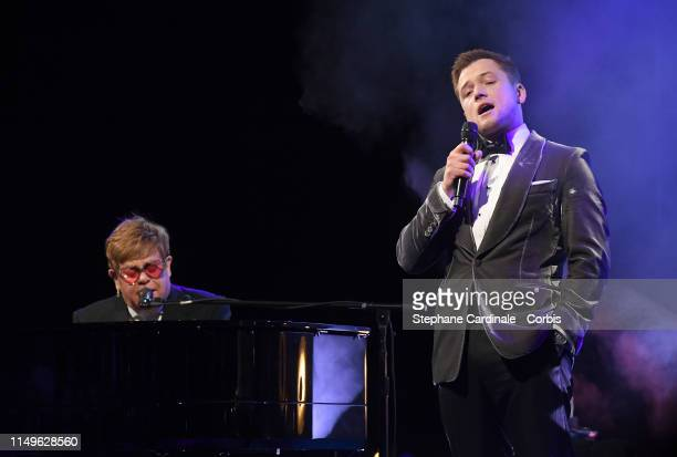 Sir Elton John and Taron Egerton perform during the Rocketman Gala Party during the 72nd annual Cannes Film Festival on May 16 2019 in Cannes France