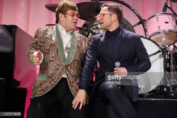 Sir Elton John and Taron Egerton perform onstage during the 27th annual Elton John AIDS Foundation Academy Awards Viewing Party sponsored by IMDb and...