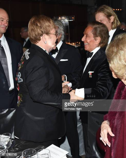 Sir Elton John and Valentino Garavani attend the Elton John AIDS Foundation Commemorates Its 25th Year And Honors Founder Sir Elton John During New...