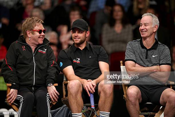 Sir Elton John Andy Roddick and John McEnroe watch on during the Mylan WTT Smash Hits on day five of the Statoil Masters Tennis at the Royal Albert...