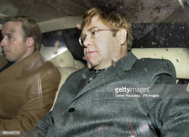 Sir Elton John arrives at the High Court in London with partner David Furnish for day two of 53 year old singer giving evidence in his multimillion...