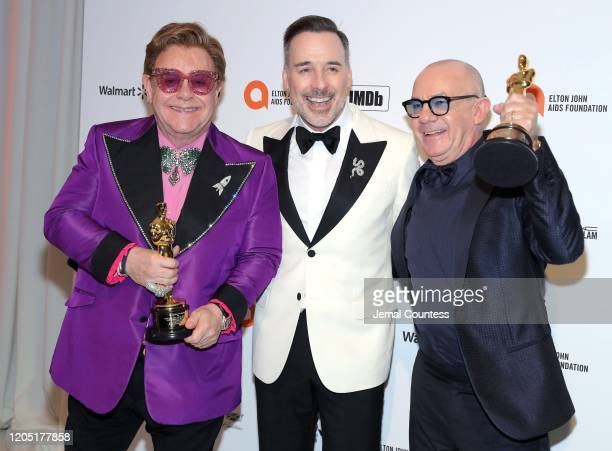Sir Elton John, David Furnish and Bernie Taupin attend the 28th Annual Elton John AIDS Foundation Academy Awards Viewing Party sponsored by IMDb,...