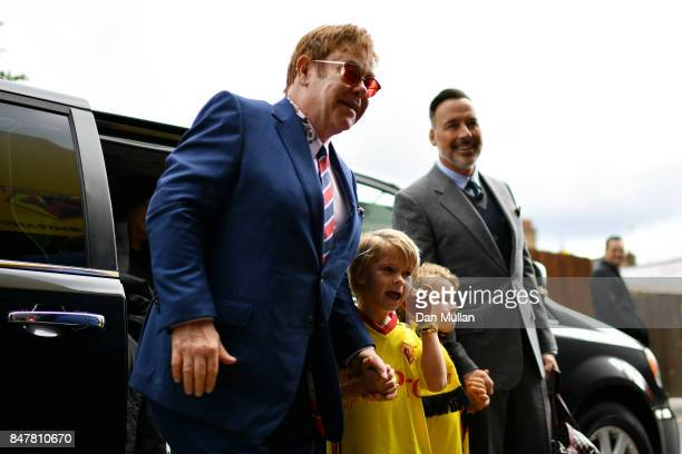 Sir Elton John, Elijah Joseph Daniel Furnish-John, Zachary Jackson Levon Furnish-John and David Furnish arrive at the stadium prior to the Premier...
