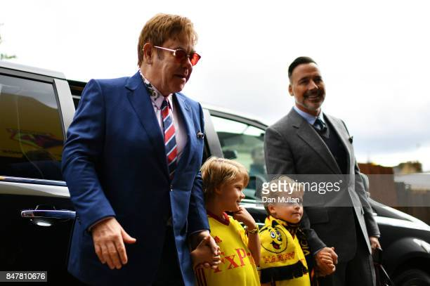 Sir Elton John, Elijah Joseph Daniel Furnish-John, Zachary Jackson Levon Furnish-John and David Furnish arrive at the stadium prior to the Premier...