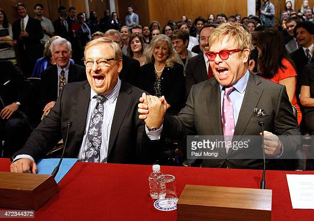 Sir Elton John , Founder, Elton John Aids Foundation, and Pastor Rick Warren shake hands before testifying at a U.S. Senate Appropriations State,...