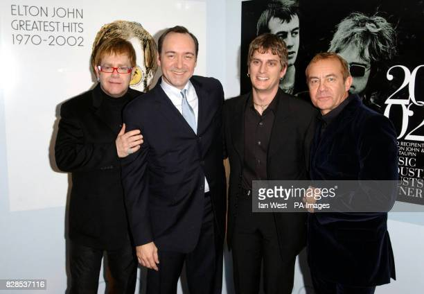 Sir Elton John Kevin Spacey Rob Thomas and Elton's songwriting partner Bernie Taupin pose for photographers as they arrive at the Music Industry...
