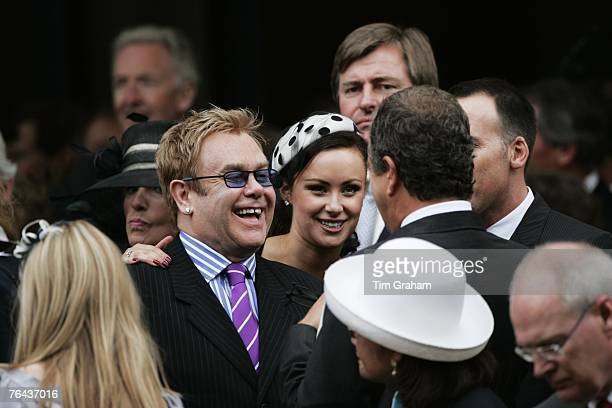 Sir Elton John laughs with photographer Mario Testino and Camilla Al Fayed after attending the 10th Anniversary Memorial Service For Diana Princess...