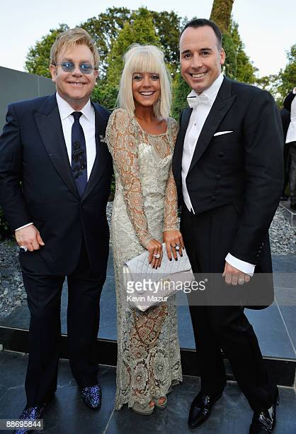 Sir Elton John, Lily Allen and John Furnish wearing Chopard Jewelry attends The 11th Annual White Tie and Tiara Ball to Benefit the Elton John Aids...