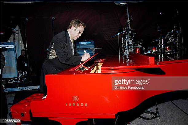Sir Elton John next to red paino during 14th Annual Elton John AIDS Foundation Oscar Party Co-hosted by Audi, Chopard and VH1 - Inside at Pacific...