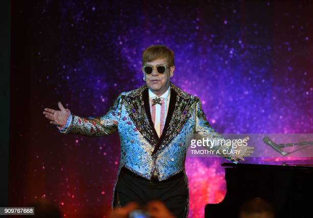 Sir Elton John performs two songs before holding a press conference in New York on January 24, 2018. Pop legend Elton John on Wednesday announced a...