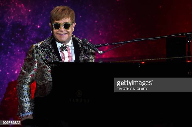 TOPSHOT Sir Elton John performs two songs before holding a press conference in New York on January 24 2018 Pop legend Elton John on Wednesday...