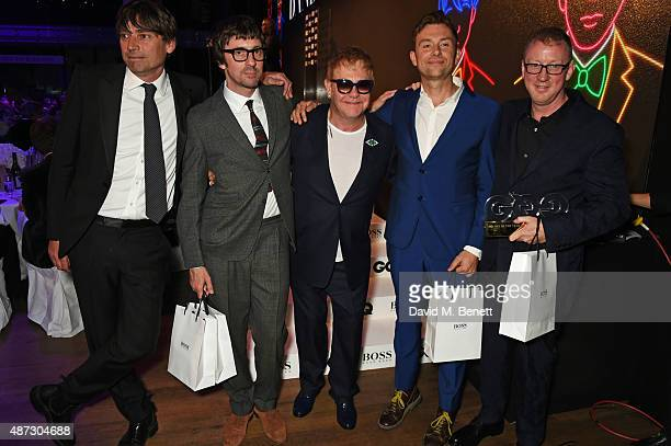 Sir Elton John poses with Band of the Year winners Alex James Graham Coxon Damon Albarn and Dave Rowntree of Blur at the GQ Men Of The Year Awards at...