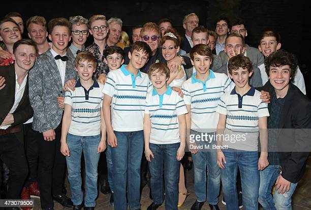 """Sir Elton John poses with cast including Ruthie Henshall as """"Billy Elliot The Musical"""" celebrates its 10th Anniversary in London's West End at the..."""
