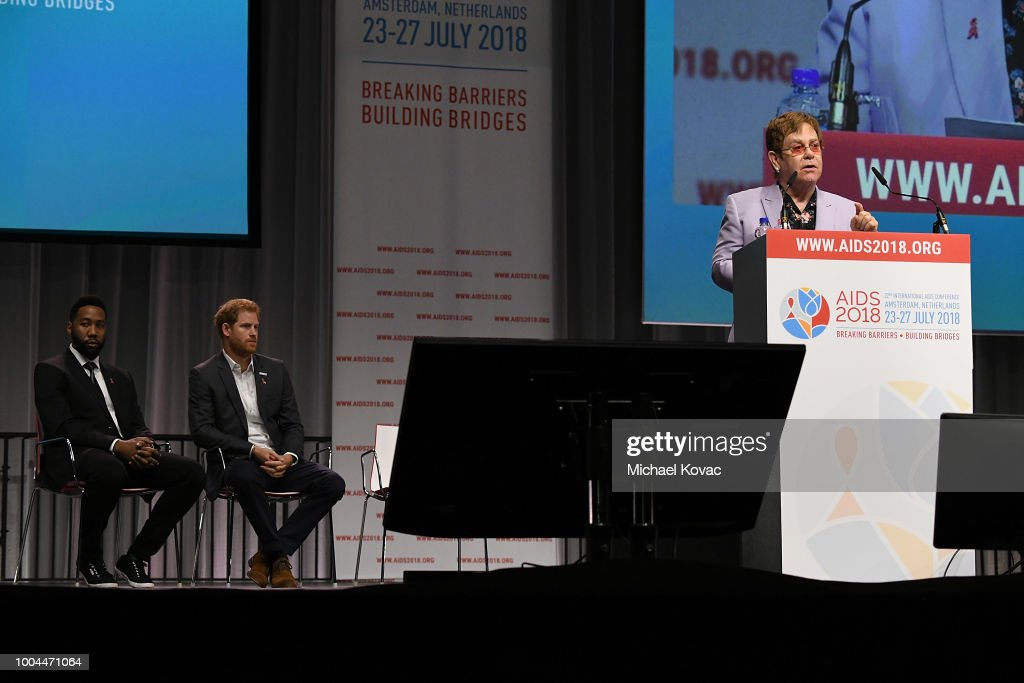 Sir Elton John presents onstage as Prince Harry, Duke of Sussex and Ndaba Mandela look on at the Launch of the Menstar Coalition To Promote HIV Testing & Treatment of Men on July 24, 2018 in Amsterdam, Netherlands.
