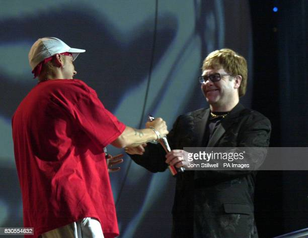 Sir Elton John presents the award for Best International Male Solo Artist to American rap star Eminem at The Brit Awards 2001 at Earls Court in London