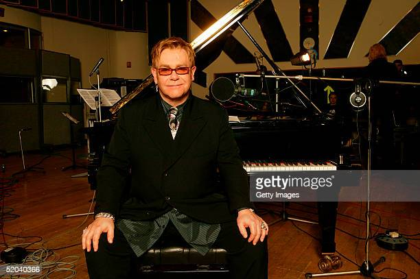 """Sir Elton John records the charity cover of Eric Clapton's """"Tears In Heaven"""" Tsunami Relief Single at Whitfield Studios on January 20, 2005 in..."""