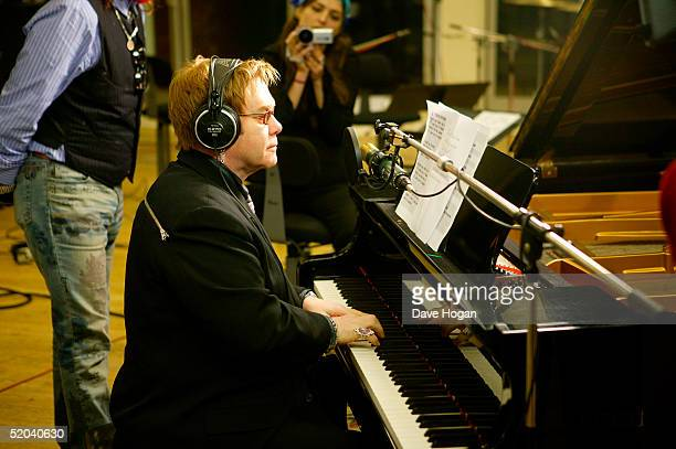 Sir Elton John records the charity cover of Eric Clapton's Tears In Heaven Tsunami Relief Single at Whitfield Studios on January 20 2005 in London...