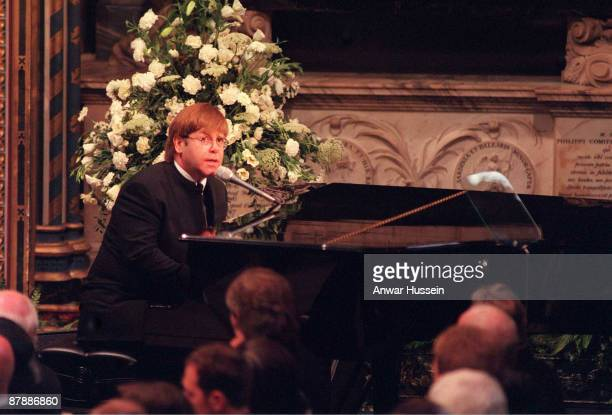 Sir Elton John signing 'Candle In The Wind' at the funeral of Diana Princess of Wales on September 6 1997