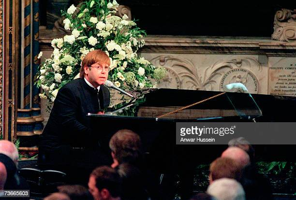 Sir Elton John sings 'Candle in the Wind' at the funeral if Diana, Princess of Wales at Westminster Abbey on September 6, 1997 in London, England.