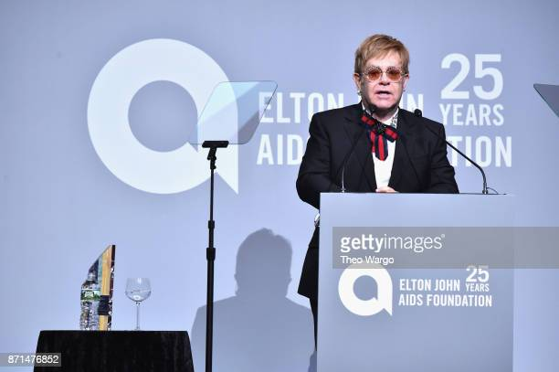 Sir Elton John speaks onstage with the Elizabeth Taylor AIDS Foundation Award at the Elton John AIDS Foundation Commemorates Its 25th Year And Honors...