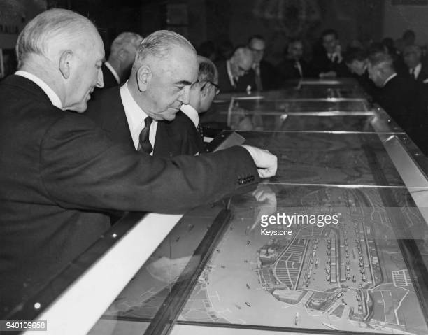 Sir Eric Harrison the Australian High Commissioner in London looks at a model of the Port of London with John Fremantle 4th Baron Cottesloe...