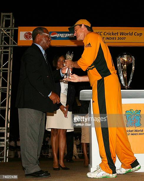 Sir Everton Weekes presents Adam Gilchrist of Australia with the Player of the Match after the ICC Cricket World Cup Final between Australia and Sri...