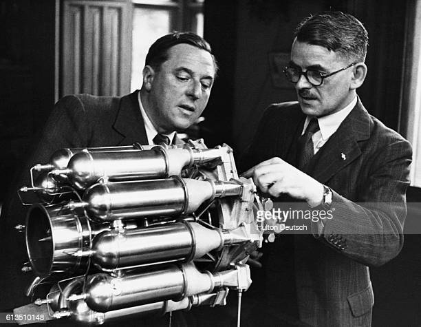 Sir Frank Whittle the English aeronautical engineer and inventor of the jet engine gives instructions in its workings to the journalist Clifford...