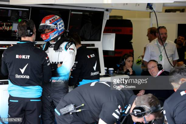 Sir Frank Williams and Williams Deputy Team Principal Claire Williams talk in the Williams garage as George Russell of Great Britain and Williams...