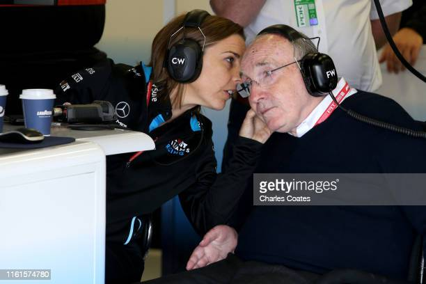 Sir Frank Williams and Williams Deputy Team Principal Claire Williams talk in the Williams garage during practice for the F1 Grand Prix of Great...